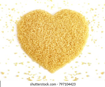Heart-shaped of Sugar from sugarcane top view, Background granulated sugar yellow brown, Sucrose from sugar cane, Red sugar