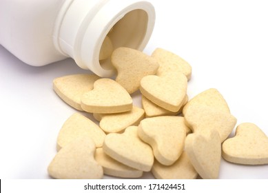 Heart-shaped Tablets  Spills from Container