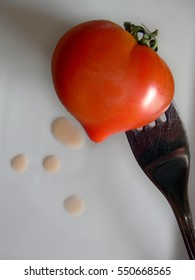 """Heart-shaped tomato representing """"healthy food"""" or """"valentine's day"""""""