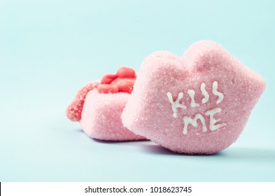 "Heart-shaped Valentines candies with ""KISS ME"" text"