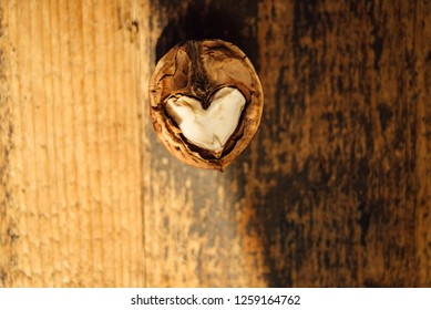 Heart-shaped walnut in shadow