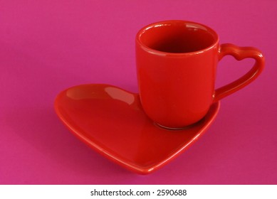 Heart-themed espresso cup on pink