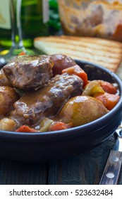 Hearty beef stew with carrot, celery, shallot and potato, vertical
