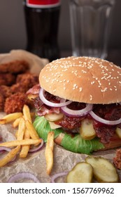 hearty Burger with meat and French fries