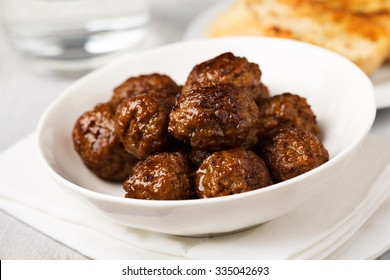 hearty meatballs served in a small bowl.