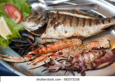 Hearty plate of various grilled seafood in Dubrovnik restaurant, Croatia