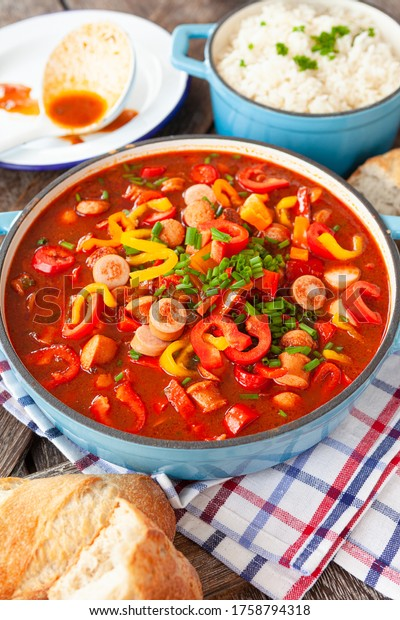 Hearty stew with German sausages and bell peppers