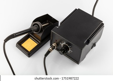 Heat adjustable Soldering Iron. Soldering station, heating control regulator, with hot air gun and soldering iron. Isolated on a white background.