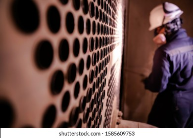 Heat exchanger tube maintenance by replacement of all tubes subjected to wall loss eddy current tube by corrosion.
