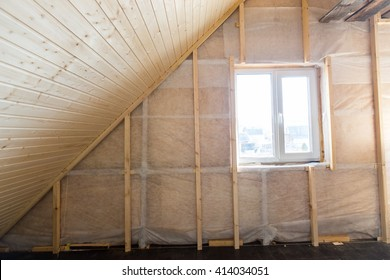 Heat insulation and wooden logs lathing ready for Finishing made of tongue and groove planks. An interior view of unfinished home inside