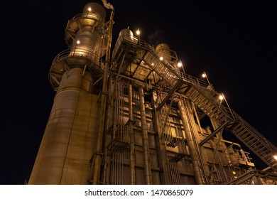 Heat recovery steam generator (HRSG) and the exhaust stack at night.