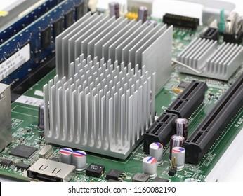 heat sink or computer processor cooler or radiator on computer motherboard.