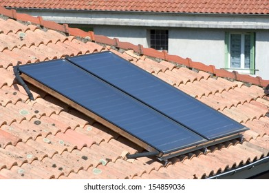 Heat solar water installed on a roof of Anduze, French city in the south-east of France.