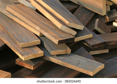 Heat treatment wood stacked together, closeup of photo