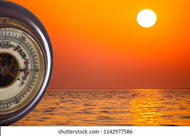 Heat wave. Barometer forecasting very dry weather against tropical sunshine background. Summer heatwave forecast with hot temperature and drought conditions. Global warming and climate change.