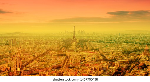 heat wave in Paris, France - burning orange sun and Eiffel tower
