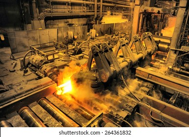 heated steel pigs on the rolling mill