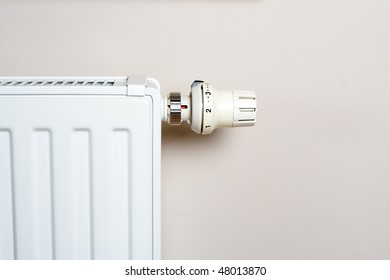 Heater and thermostat on wall