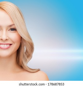 heath and beauty concept - closeup of clean face and shoulders of beautiful young woman