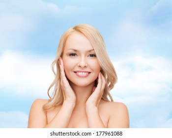 heath and beauty concept - face of beautiful woman touching her face skin