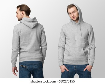 Heather grey hoodie on a young man in jeans, isolated, front and back, mockup.