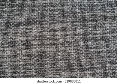 Heather grey knitted fabric made of synthetic yarn. Textured background