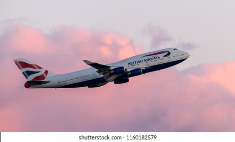 Heathrow Airport, London, England on August 16 2018. British Airways Boeing 747 departing at sunset