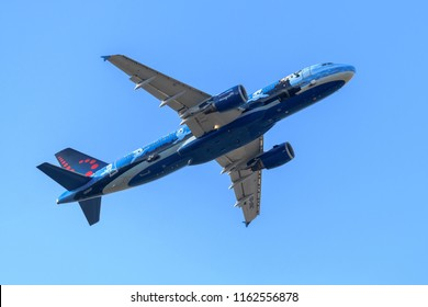 Heathrow Airport, London, England on August 17 2018. Brussels Airlines Airbus A320 with special livery of a painting by the artist Magritte departing