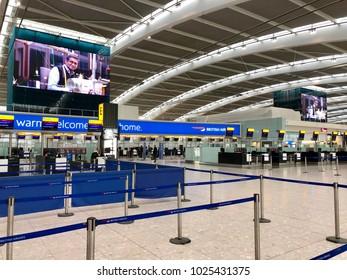 HEATHROW AIRPORT, LONDON - FEBRUARY 14, 2018: British Airways checkin and baggage drop desks on the landslide departures level in Terminal 5, Heathrow Airport, London, UK.