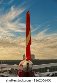 HEATHROW AIRPORT, LONDON - JULY 2018: Rear view of the tail fin of a Qantas Airbus A380 airliner as the sun sets at London Heathrow Airport.