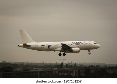 Heathrow airport, UK / May 16th, 2018. Cobalt Air Airbus A320 is landing in Runway 09L in Heathrow Airport.