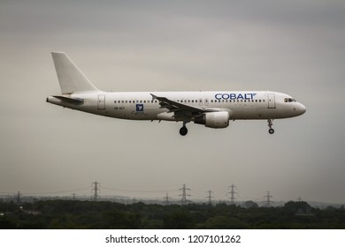 Heathrow airport, UK / May 16th, 2018. Cobalt Air Airbus A320 is landing in Runway 09L in Heathrow Airport.