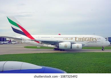HEATHROW, ENGLAND -23 APR 2018- View of an Airbus A380 airplane from Dubai airline Emirates (EK) at the London Heathrow Airport (LHR) near London, United Kingdom.
