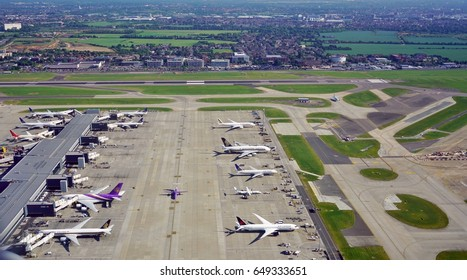 HEATHROW, ENGLAND -26 MAY 2017- View of airplanes from British Airways (BA) at the T2 Terminal 2 Queen's Terminal, dedicated to Star Alliance, at London Heathrow Airport (LHR) in London.
