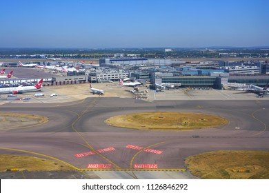 HEATHROW, ENGLAND -27 JUN 2018- Aerial view of airplanes at the Terminal 3 at London Heathrow Airport (LHR), the main airport in London.