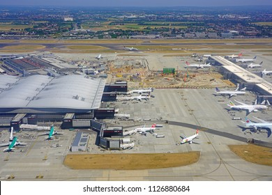 HEATHROW, ENGLAND -27 JUN 2018- Aerial view of airplanes at the Star Alliance Terminal 2 at London Heathrow Airport (LHR), the main airport in London.