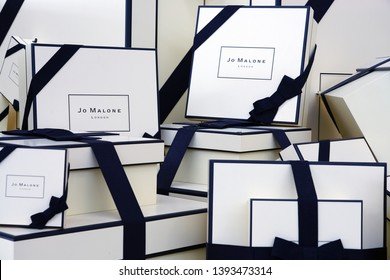 HEATHROW, ENGLAND -3 APR 2019- View of black and white packages by Jo Malone, a British perfume and scented candle brand owned by Estée Lauder.