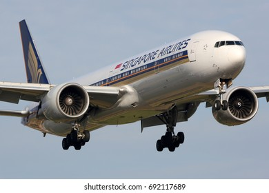 HEATHROW, LONDON, UNITED KINGDOM - JULY 7, 2017: Boeing 777-300ER 9V-SWT of Singapore Airlines landing at Heathrow international airport.