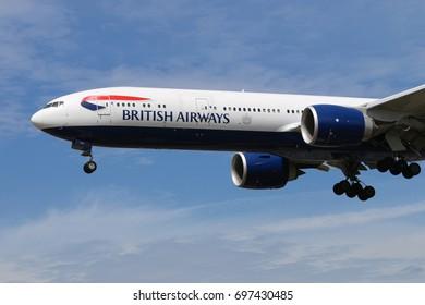 HEATHROW, LONDON, UNITED KINGDOM - JULY 7, 2017: Boeing 777-300ER G-STBH of British Airways landing at Heathrow international airport.