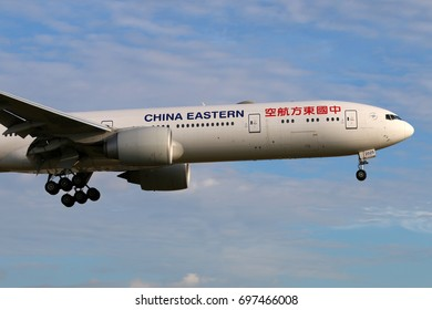 HEATHROW, LONDON, UNITED KINGDOM - JULY 7, 2017: Boeing 777-300ER B-2025 of China Eastern Airlines landing at Heathrow international airport.