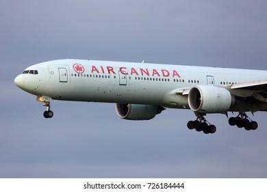 HEATHROW, LONDON, UNITED KINGDOM - JULY 13, 2017: Boeing 777-300ER C-FIUV of Air Canada landing at Heathrow international airport.