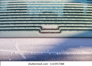 heating the back glass windscreen in the car in winter morning