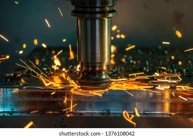 The  heating  chip on CNC machining centre  from tool wear. The CNC milling machine cutting the mold part with the index-able radius end mill tool in roughing process.
