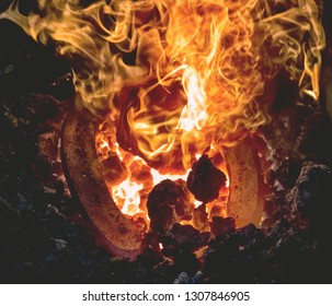 Heating of horseshooe. Mobile fireplace - coal forge with extremly hot fire used by blacksmith