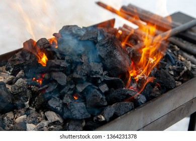 Heating of metal billets on the fire for a hand-forged metal.