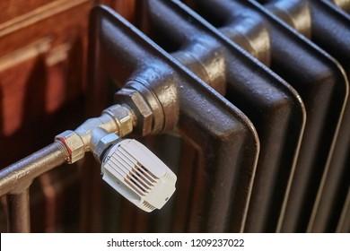 Heating radiator detail with adjusting knob