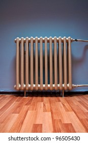 Heating radiator in a room with laminated wooden floor