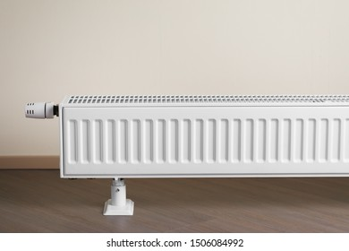 heating radiator with thermostatic knob in the living room