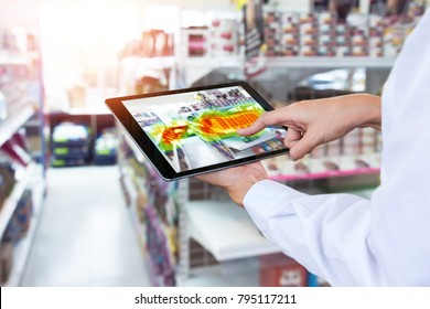 Heatmap Analytic in smart retail shop technology concept. Hand using smart tablet with Pheat sense application check shoppers passed from any point in store.