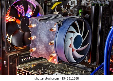 Heatsink and fan of central processing or the CPU cooler inside pc system unit. Cooling is required to remove the waste heat produced by computer components.